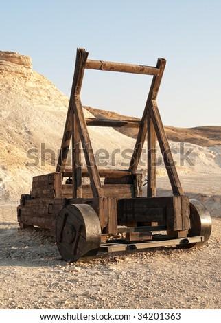 Roman Catapult. Old siege machinery in Masada. Israel - stock photo