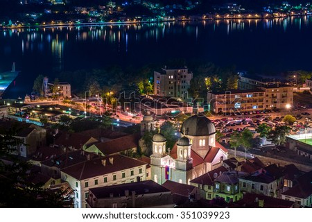 Roman Catholic Cathedral of St Tryphon and touristic old town of Kotor night photo. Montenegro - stock photo