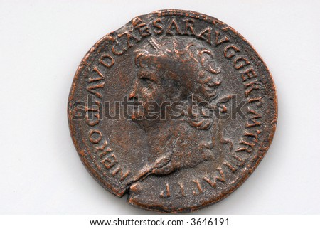 Roman coin depicting Sestertius of Nero showing the portrait of a Roman soldier on a white background - stock photo