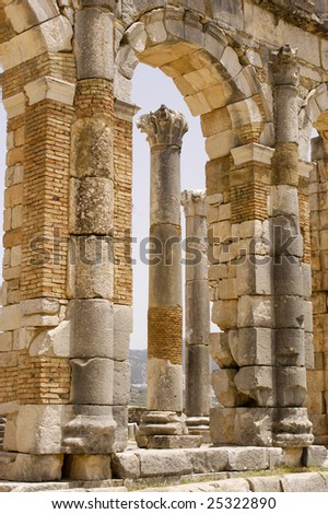 Roman columns framed in an arch at Volubilis, Morocco - stock photo
