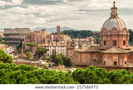 Roman Forum and Coliseum in the distance in Rome, Italy - stock photo