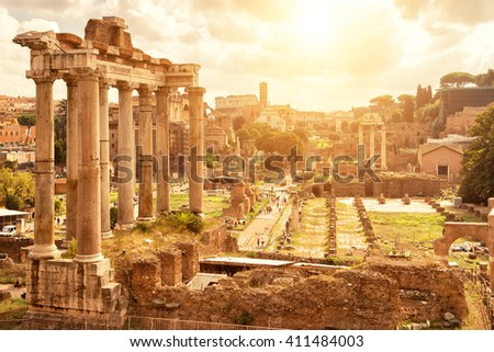 Roman Forum in Rome, Italy. Ruins of the Temple of Saturn in the foreground. - stock photo