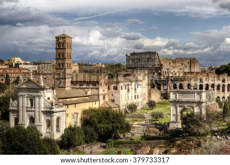 Roman Forum. The Temple of Venus and Roma, Church of Santa Francesca Romana, The Arch of Titus, The Colosseum. Rome, Italy. - stock photo