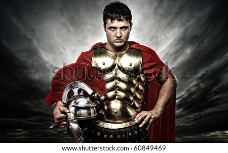 Roman legionary soldier over stormy sky - stock photo
