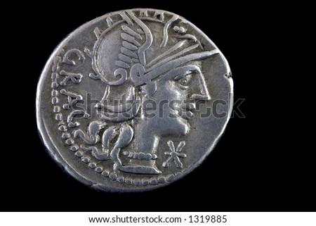 Roman republican denarius of Lucius Antestius Gragulus 136 BCE. Helmeted head of Roma right ,GRAG behind. - stock photo