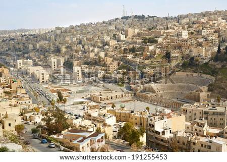 Roman theater and city view of Amman, Jordan  - stock photo