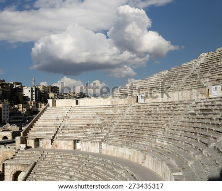 Roman Theatre in Amman, Jordan -- theatre was built the reign of Antonius Pius (138-161 CE), the large and steeply raked structure could seat about 6000 people - stock photo