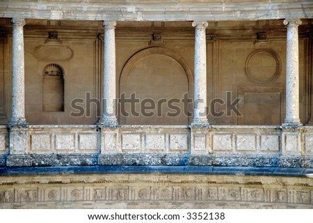 Roman theme - styled columns in Alhambra Palace, Spain - stock photo