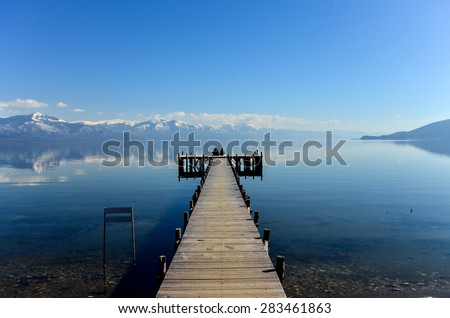 Romance on a pier of Lake Prespa, Macedonia  - stock photo