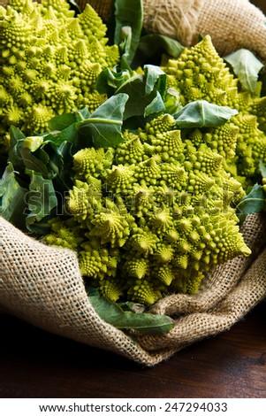 Romanesco broccoli cabbage on wood - stock photo
