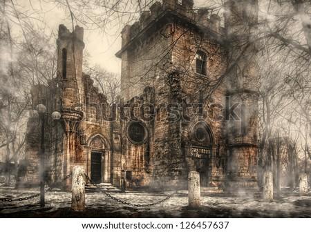 Romanescu park Romania.spooky transilvanian castle.A beautiful derelict castle in a fogy day - stock photo