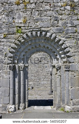 Romanesque Archway of Church. Focus on arch and doorway surfaces. - stock photo