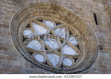 Romanesque cathedral rose window of a small town in southern Spain. - stock photo