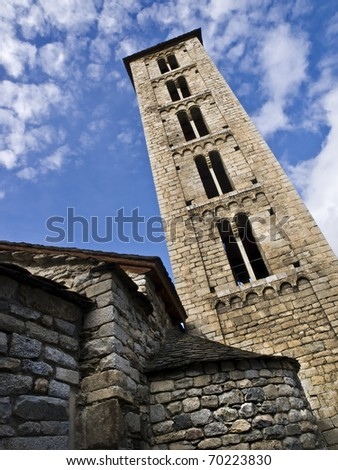 Romanesque church in the Spanish Pyrenees. View taken from below, with the bell tower tilted - stock photo