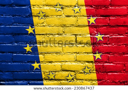 Romania and European Union Flag painted on brick wall - stock photo