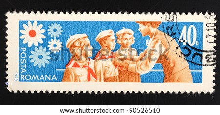 ROMANIA - CIRCA 1968: A 40 bani stamp printed in Romania shows image of Pioneers receiving scarves, circa 1968 - stock photo