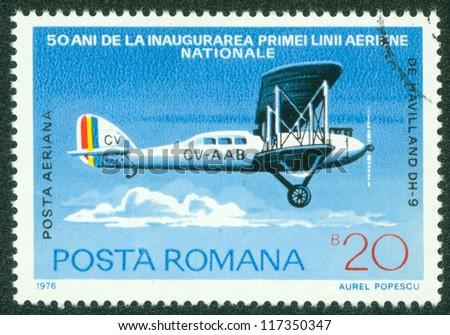 ROMANIA - CIRCA 1976: A stamp printed by Romania, shows airplane, circa 1976. - stock photo