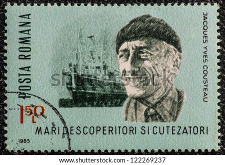 ROMANIA - CIRCA 1985: A stamp printed in Romania, show Jacques Yves Cousteau, a French naval officer, explorer, filmmaker, innovator, scientist and researcher with his vessel Calypso, circa 1985 - stock photo