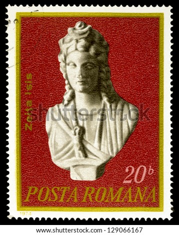 """ROMANIA - CIRCA 1974: A stamp printed in Romania, shows Bust of Goddess Isis, 1st century, Constanza, with inscription and name of series """"Ancient artworks excavated in Romania"""", circa 1974 - stock photo"""