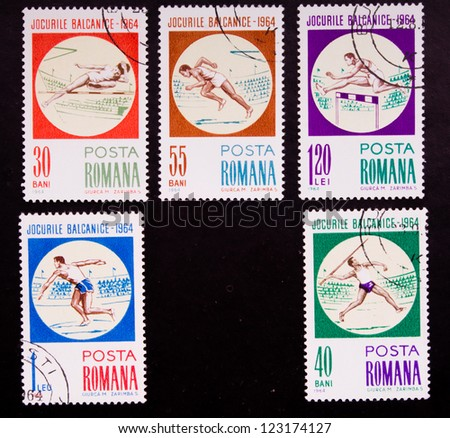 ROMANIA - CIRCA 1964: A stamp printed in Romania shows different kind of sport high jumping,running and throwing a stick, circa 1964. - stock photo