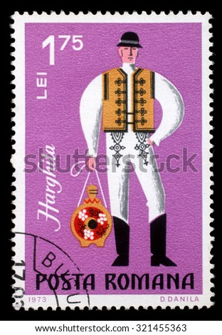 ROMANIA - CIRCA 1973: A stamp printed in Romania shows image of a Harghita man, from the regional costumes series, circa 1973 - stock photo