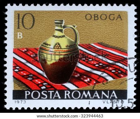 ROMANIA - CIRCA 1973: a stamp printed in Romania shows Oboga from the series Romanian pottery, circa 1973. - stock photo