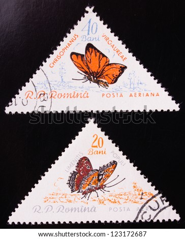 ROMANIA - CIRCA 1960: A stamp printed in Romania shows two kinds of orange butterflies , circa 1960. - stock photo
