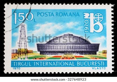 ROMANIA - CIRCA 1970: a stamp printed in the Romania shows Exhibition Hall and Oil Derrick, International Bucharest Fair, circa 1970 - stock photo