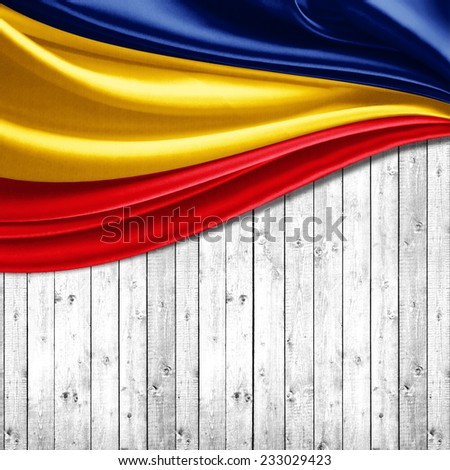 Romania flag and wood background - stock photo