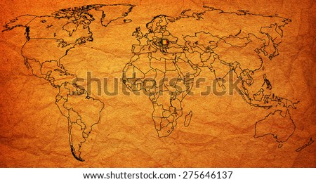 romania flag on old vintage world map with national borders - stock photo