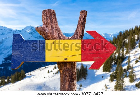 Romania Flag wooden sign with winter background - stock photo