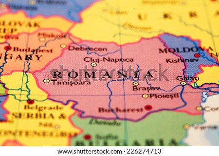 Romania on atlas world map - stock photo