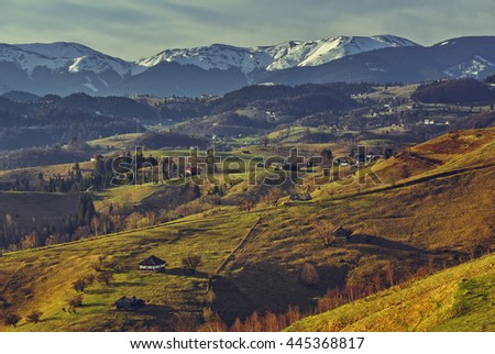 Romanian rural landscape with traditional Romanian scattered houses in the valleys of Bucegi mountains uphill in Sirnea village, Brasov county, Romania. - stock photo