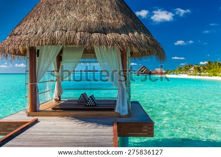Romantic and luxurious overwater spa with panoramic tropical lagoon view - stock photo