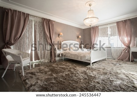 Romantic beauty bedroom interior with soft carpet - stock photo