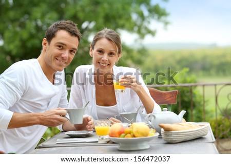 Romantic breakfast in hotel garden - stock photo