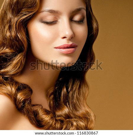 romantic brunette with curly hair - stock photo