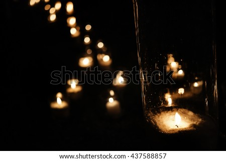 romantic candle light in glass lanterns  at luxury wedding ceremony in evening, decor and arrangements - stock photo