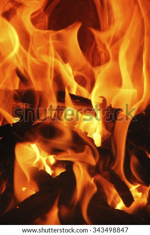 romantic chimney fire with burning logs - stock photo