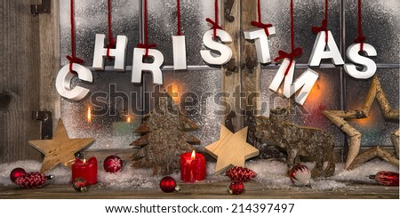 Romantic christmas card in red and white colors with candles in the window. - stock photo