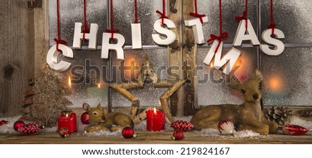 Romantic christmas decoration with candles in red and white color. - stock photo