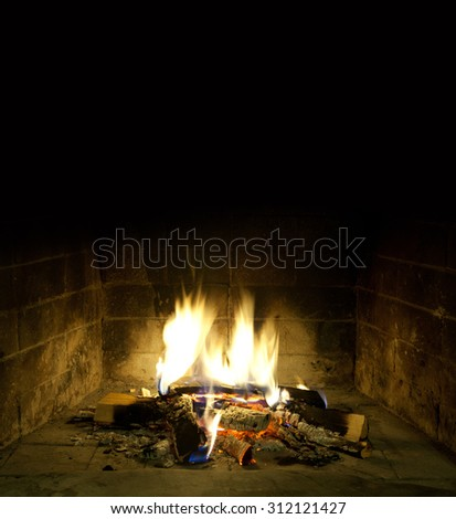 Romantic christmas interior. Relax time concept. Fireside. Winter design postcard template with grate. hearth. Hotbed, fireplace,  furnace. Black background, copy space. - stock photo