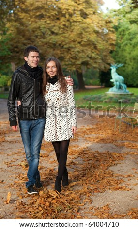 Romantic coouple in the Luxembourg garden of Paris, walking - stock photo