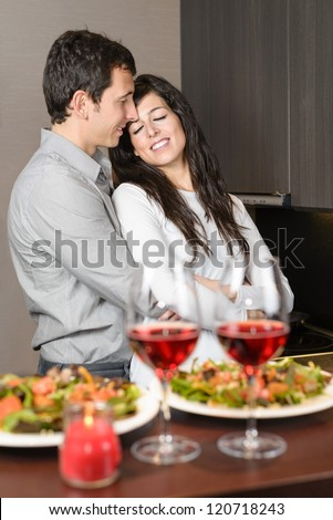 Romantic couple anniversary dinner.Young couple embracing with love during date. Loving boyfriend and girlfriend. - stock photo