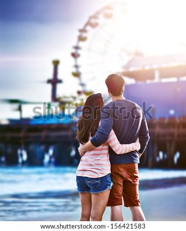 romantic couple at santa monica pier - stock photo