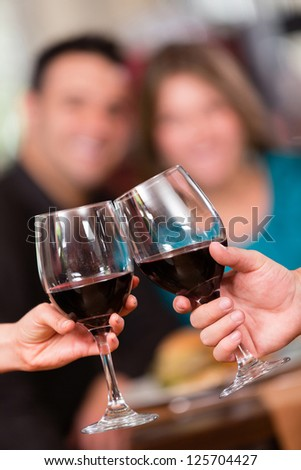 Romantic couple celebrating an anniversary with wine - stock photo