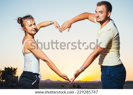 romantic couple during tropical vacation. Romantic Wedding Couple hugging on the tropical Beach at Sunset. Love story - stock photo
