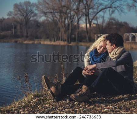 romantic couple embraces in the field - stock photo