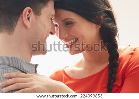 Romantic Couple Embracing Indoors - stock photo