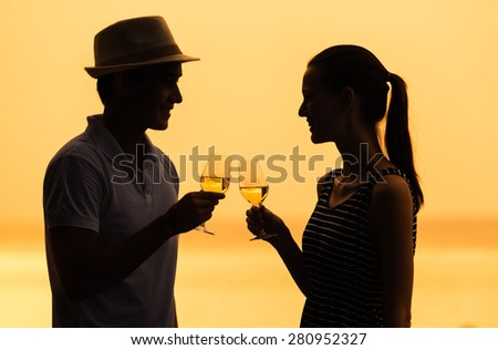 Romantic couple enjoying a glass of wine.  - stock photo
